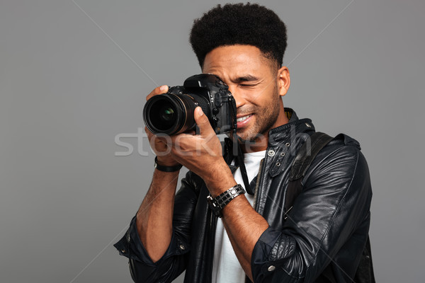 Portrait of a smiling afro american male photographer Stock photo © deandrobot