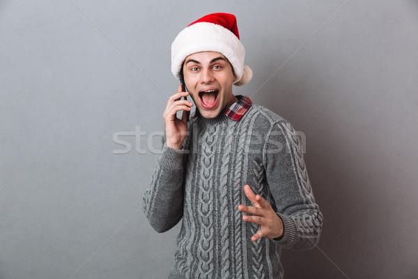 Emocjonalny człowiek christmas Święty mikołaj hat Zdjęcia stock © deandrobot