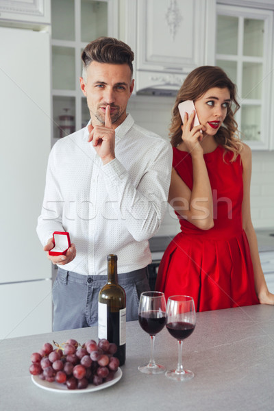 Portrait of a handsome man proposing to his girlfriend Stock photo © deandrobot