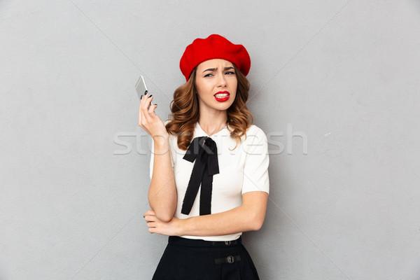 Retrato irritado aluna uniforme falante telefone móvel Foto stock © deandrobot