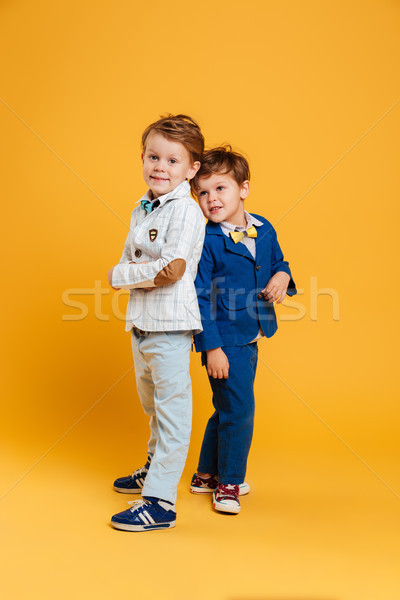 Two funny little children brothers Stock photo © deandrobot