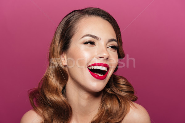 Young amazing lady laughing isolated over pink Stock photo © deandrobot