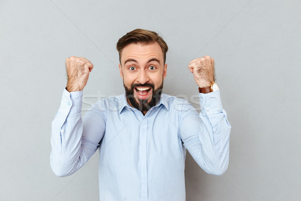 Happy screaming bearded man in business clothes looking at camera Stock photo © deandrobot