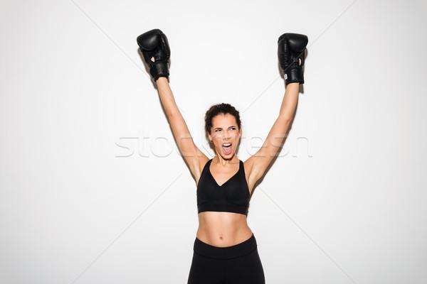 Stockfoto: Gelukkig · schreeuwen · gekruld · brunette · fitness · vrouw · handen