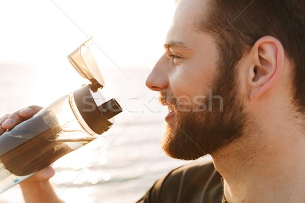 Сток-фото: счастливым · молодые · спортсмен · питьевая · вода · бутылку
