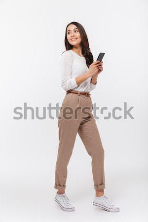 Tam uzunlukta portre mutlu Asya işkadını cep telefonu Stok fotoğraf © deandrobot