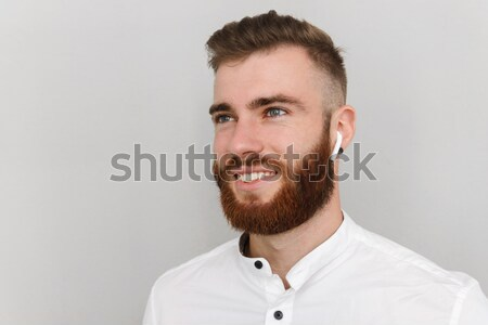 Close up portrait of a smiling young man Stock photo © deandrobot