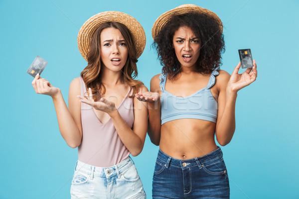 Due confusi giovani ragazze estate vestiti Foto d'archivio © deandrobot