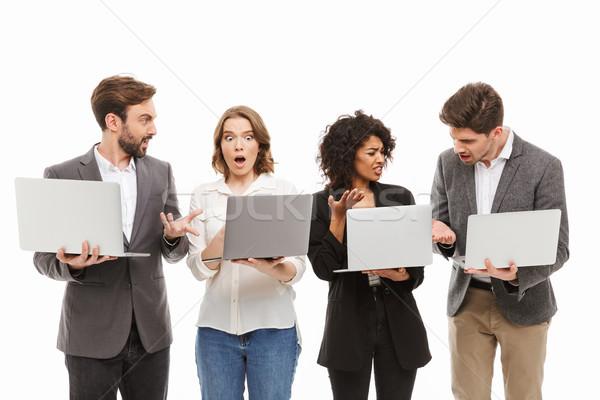 Ritratto gruppo confusi uomini d'affari laptop Foto d'archivio © deandrobot