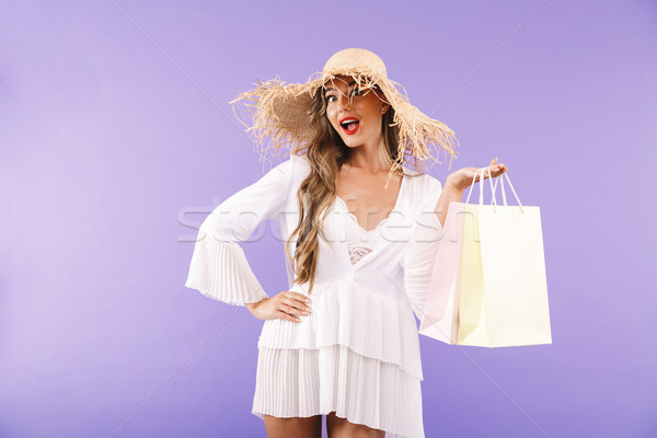 Portrait of a cheerful young woman in white dress Stock photo © deandrobot