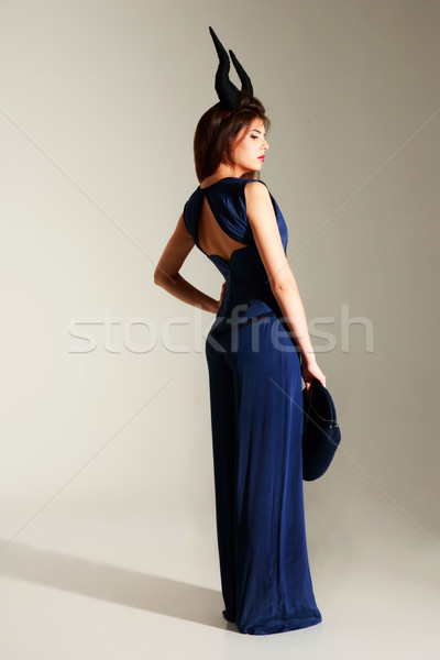 Full length portrait of a beautiful woman in blue dress on gray background Stock photo © deandrobot