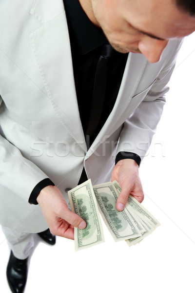Confident businessman holding US dollars Stock photo © deandrobot