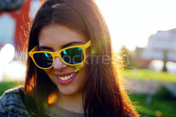 Closeup portrait of a cheerful trendy woman Stock photo © deandrobot