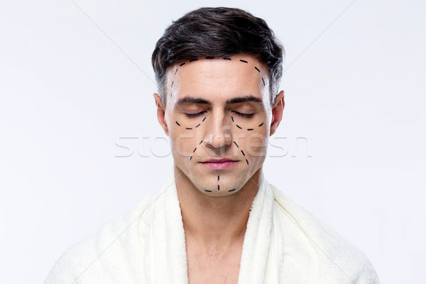 Man with closed eyes and marked with lines for plastic surgery Stock photo © deandrobot