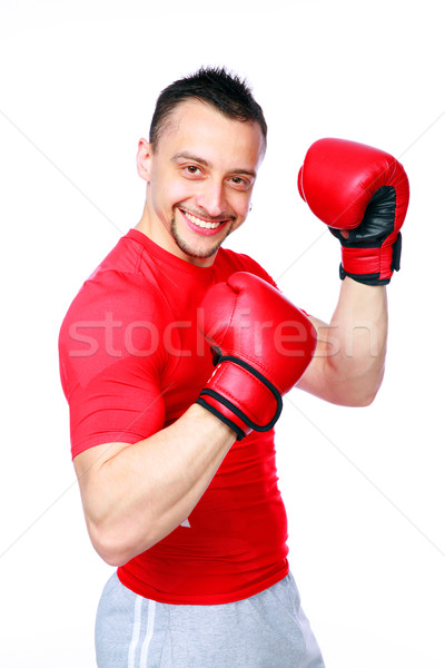 Smiling sportsman in boxing gloves standing over white background Stock photo © deandrobot