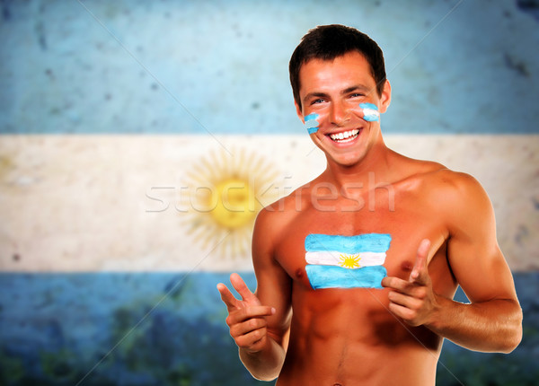 Cheering argentinian soccer fan over argentina flag background Stock photo © deandrobot
