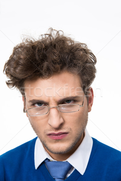 Angry man in glasses looking at camera Stock photo © deandrobot