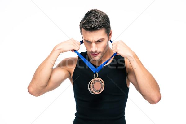 Fitness homme médaille isolé blanche heureux Photo stock © deandrobot