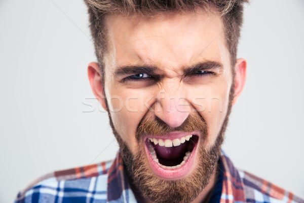 Portrait of a young man screaming  Stock photo © deandrobot