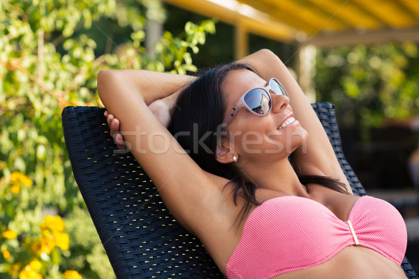 Stock photo: Happy woman sunbathing on the deckchair