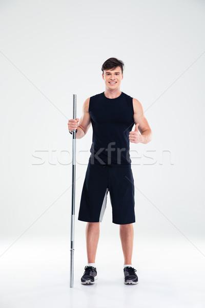 Fitness człowiek sztanga kciuk Zdjęcia stock © deandrobot