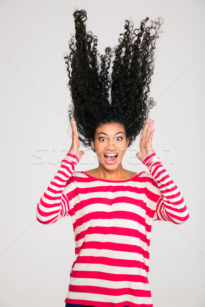 Portriat of scared afro american woman screaming Stock photo © deandrobot