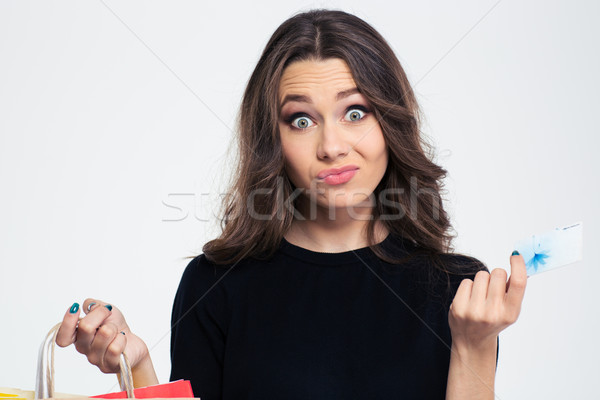 Woman holding shopping bags and bank card Stock photo © deandrobot