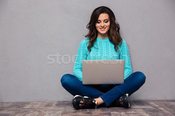 Woman using laptop computer on the floor  Stock photo © deandrobot