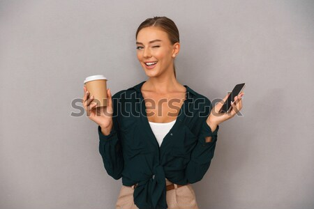 Mosolyog nő sportruha tart shaker portré Stock fotó © deandrobot