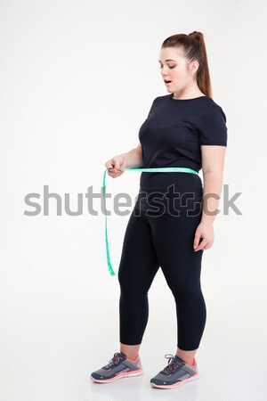 Fat woman measuring her waist Stock photo © deandrobot