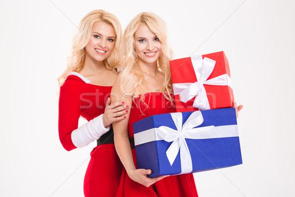 Kettő gyönyörű nővérek ikrek mikulás jelmezek Stock fotó © deandrobot