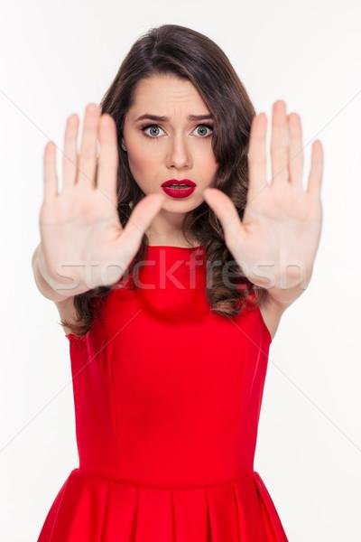 Vrouw tonen stopteken palmen portret jonge vrouw Stockfoto © deandrobot