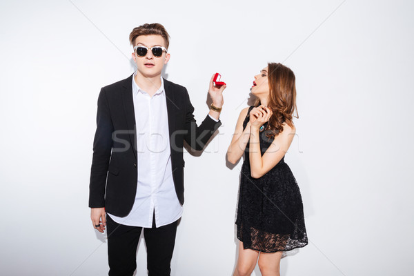 Man making proposal with ring to his girlfriend  Stock photo © deandrobot