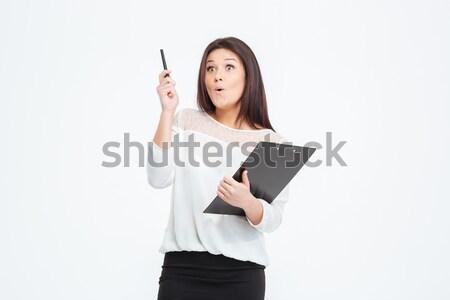 Maravilhado empresária clipboard em pé isolado branco Foto stock © deandrobot
