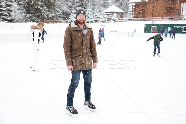 Mosolyog férfi korcsolyázás kint hó boldog Stock fotó © deandrobot
