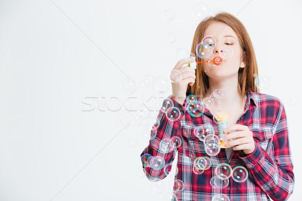 женщину мыльные пузыри изолированный белый пространстве Сток-фото © deandrobot
