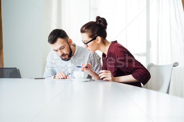 Iki konsantre ofis genç Stok fotoğraf © deandrobot