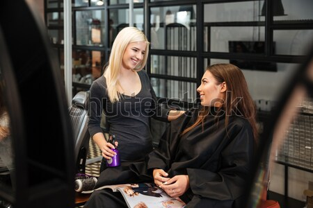 Woman discussing haircut with her hairdresser in the hairdressing salon Stock photo © deandrobot