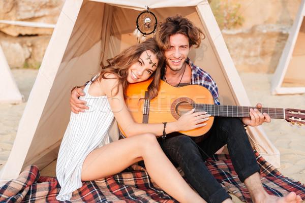 Pár ül gitár tengerpart sátor boldog Stock fotó © deandrobot
