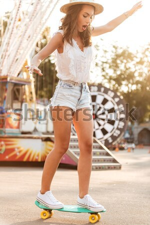 Surprised woman in hat with backpack standing on the street Stock photo © deandrobot