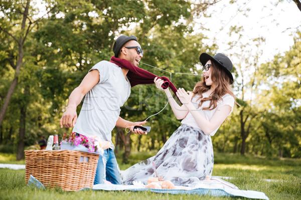 Boldog pár szórakozás zenét hallgat piknik fiatal pér Stock fotó © deandrobot