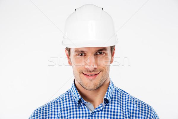 Közelkép mosolyog fiatalember építész védősisak terv Stock fotó © deandrobot