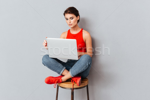 Young beautiful smart girl using laptop pc computer for study Stock photo © deandrobot