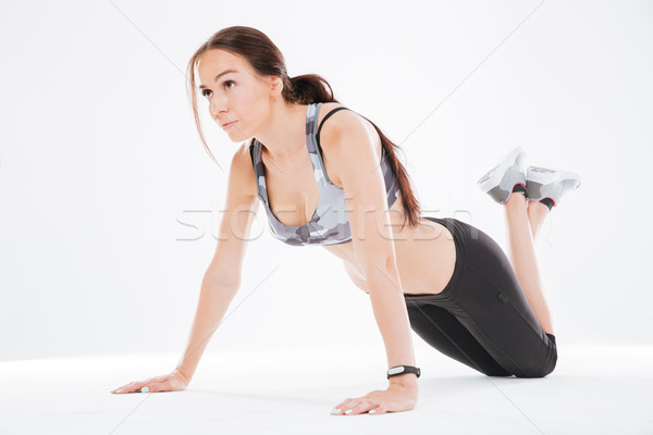 Young fitness woman on the floor Stock photo © deandrobot
