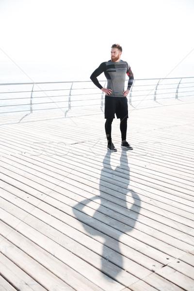 Stock photo: Full length runner near the sea