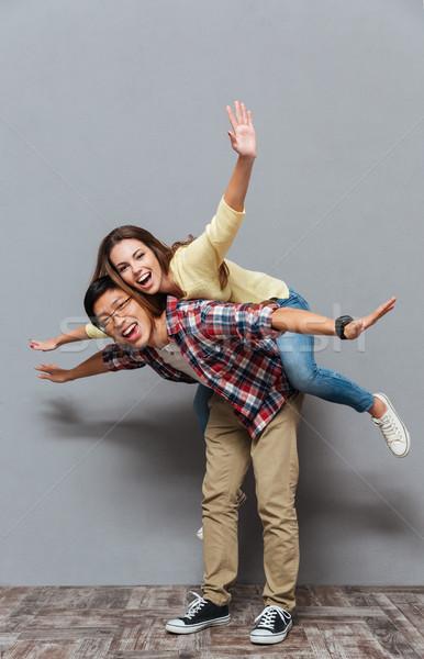 Retrato jovem casal piggyback Foto stock © deandrobot