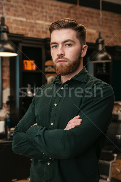 Man standing in barbershop and looking at camera. Stock photo © deandrobot