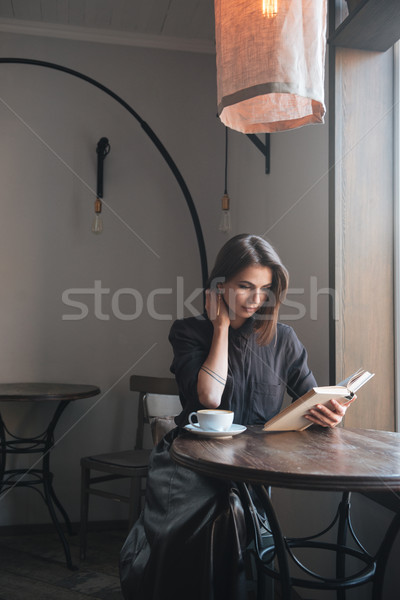 Young Woman Sits At White Table Stock Tubecup 1