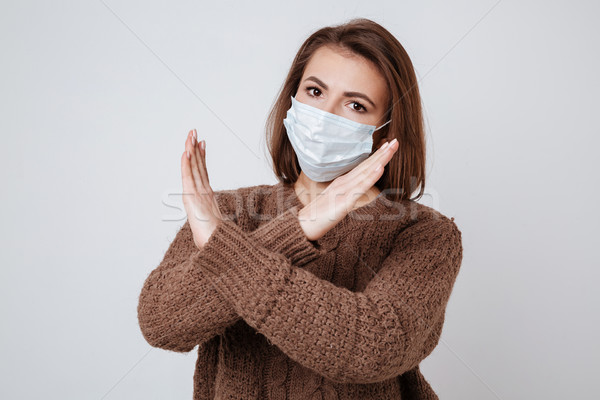 Sick Woman in sweater and medical mask Stock photo © deandrobot