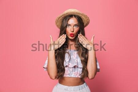Szexi szokatlan modell telefonkagyló másfelé néz izolált Stock fotó © deandrobot